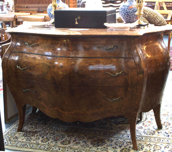 An Italian Burr Walnut Bombe Commode