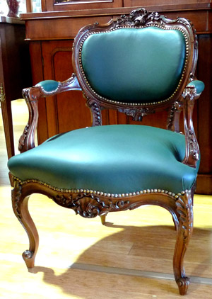 A Pair of French Walnut Chairs with Green Leather Upholstery