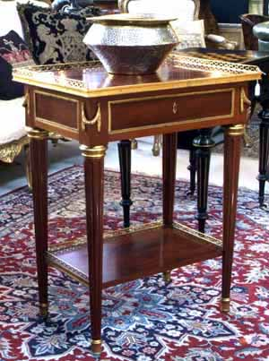 A French gilt bronze mahogany table signed Fundaco